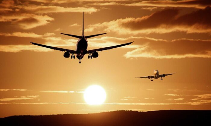 In this file photo, aircraft are seen flying away from and towards the setting sun. (ThePixelman/Pixabay)