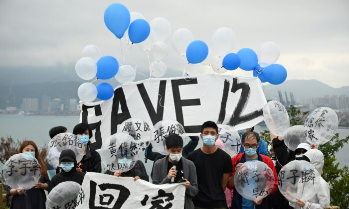 Four families and members of the Save12HKers campaign group prepare to fly balloons towards Yantian, in mainland China (back) at Crooked Island, in Hong Kong, on Nov. 21, 2020. (Peter Parks/AFP via Getty Images)