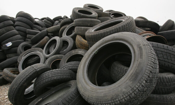 Discarded car tires lie at a depot for wrecked and abandoned cars in Schopsdorf, Germany, on March 9, 2007. (Sean Gallup/Getty Images)