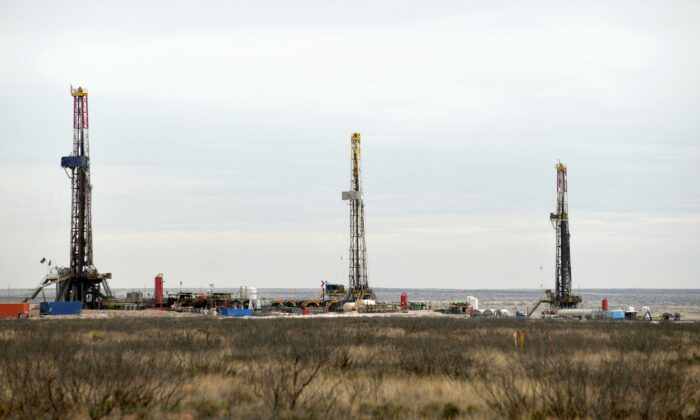 Drilling rigs operate in the Permian Basin oil and natural gas production area in Lea County, N.M., on Feb. 10, 2019. (Nick Oxford/Reuters)