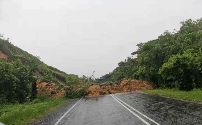 A landslide is seen on Kings Road in Viwa, as Cyclone Yasa passes through Fiji, Dec. 17, 2020, in this photo obtained from social media.  (Fiji Roads Authority/via Reuters)