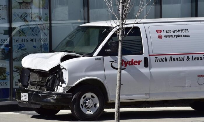 A van with a damaged front-end is shown on a sidewalk after a van mounted a sidewalk crashing into a number of pedestrians in Toronto, on April 23, 2018. (The Canadian Press/Frank Gunn)