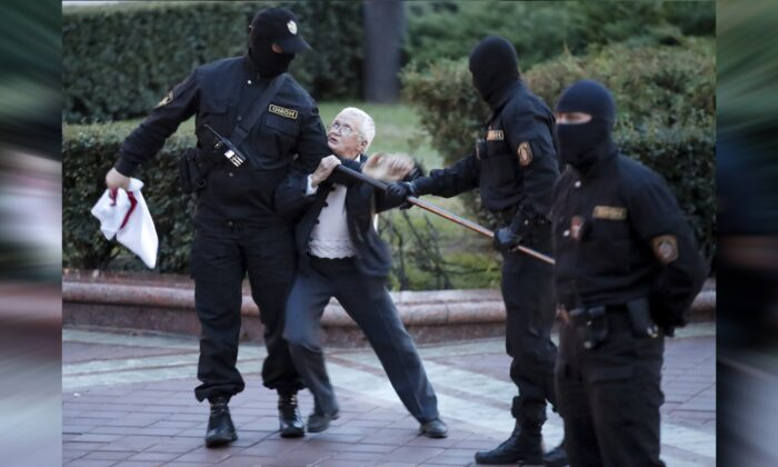 Opposition activist Nina Baginskaya, 73, center, struggles with police during a Belarusian opposition supporters rally at Independence Square in Minsk, Belarus, on Aug. 26, 2020. Police in Belarus have dispersed protesters who gathered on the capital's central square, detaining dozens. The crackdown in Independence Square on Wednesday comes on the 18th straight day of protests pushing for the resignation of Belarus' authoritarian President Alexander Lukashenko. (Dmitri Lovetsky/AP Photo)
