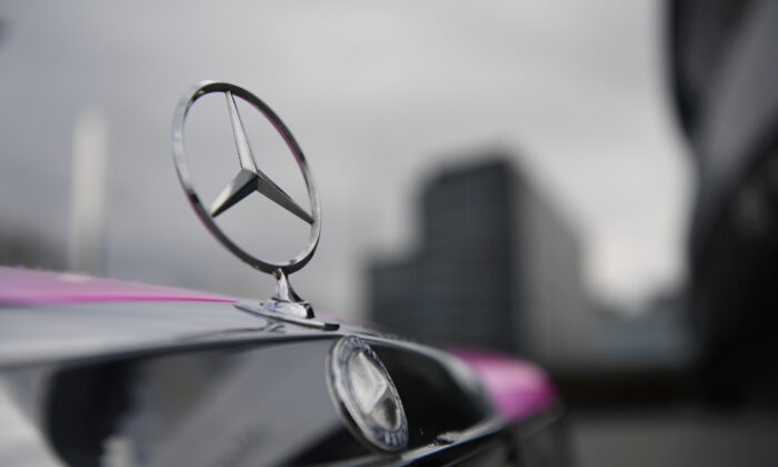 The Mercedes-Benz logo is seen on a car in front of the Mercedes-Benz Museum in Stuttgart, Germany, on Feb. 11, 2020. (Andreas Gebert/Reuters)
