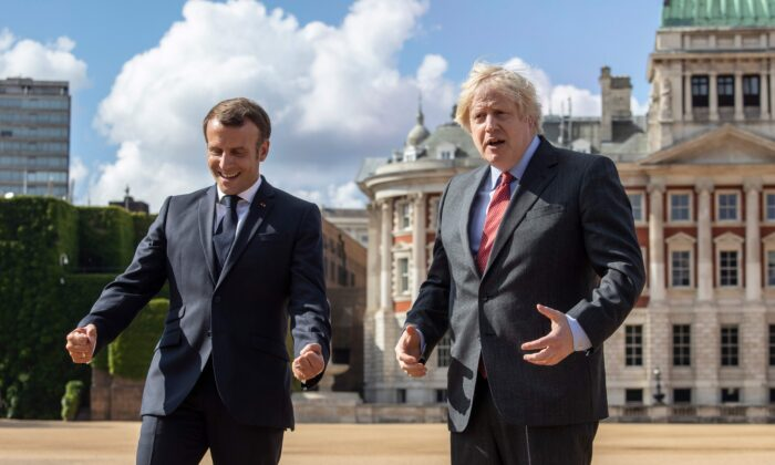 Britain's Prime Minister Boris Johnson (R) and French President Emmanuel Macron (L) on Horse Guards Parade in London, on June 18, 2020, to watch a flypast during a visit to mark the anniversary of former French president Charles de Gaulle's appeal to French people to resist the Nazi occupation during World War II. (Jack Hill/Pool/AFP via Getty Images)