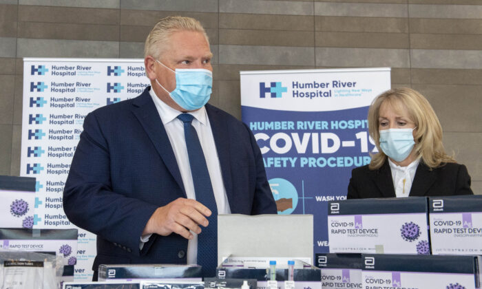 Ontario Premier Doug Ford and Long-Term Care Minister Merrilee Fullerton listen as they are briefed on COVID-19 Rapid Test Device kits at Humber River Hospital in Toronto, on Nov. 24, 2020. (Frank Gunn/The Canadian Press)