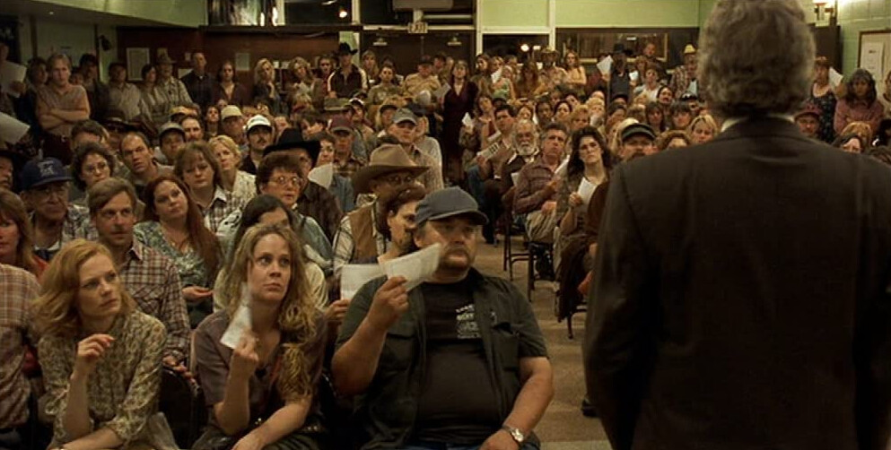 "man talks to crowd in ""Erin Brockovich"""