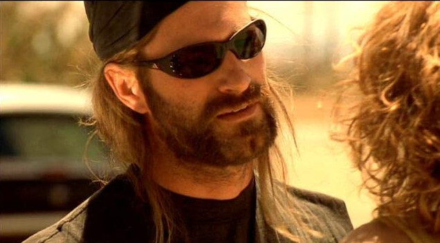 """man with sunglasses and bandana talks to woman in """"Erin Brockovich"""""""