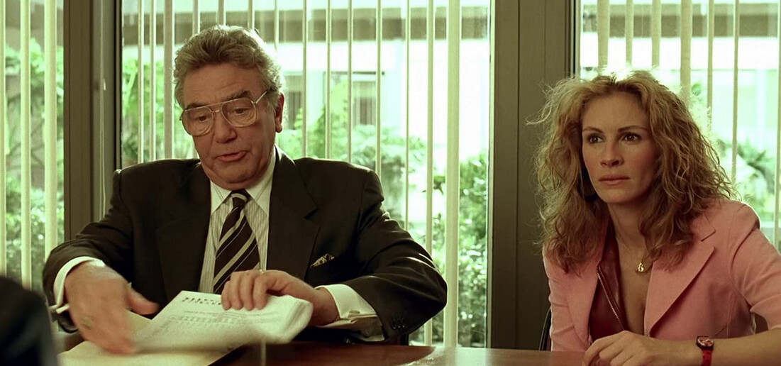 """man with tie, woman with pink coat in """"Erin Brockovich"""""""