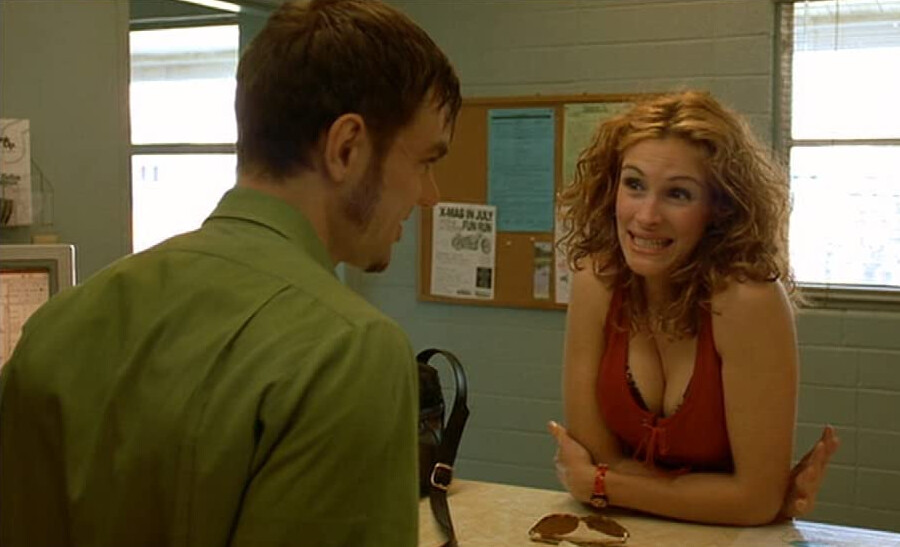 """man in green shirt and woman in red tank top in """"Erin Brockovich"""""""