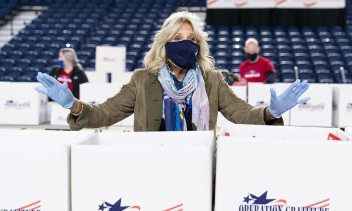 Jill Biden speaks to the media as she assembles care packages for military families for the holiday season in Washington, on Dec. 10, 2020. (Joshua Roberts/Getty Images)