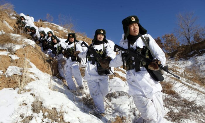 Soldiers take part in a winter training session in freezing temperatures in Heihe, northeast China, on Jan. 28, 2015. (STR/AFP via Getty Images)