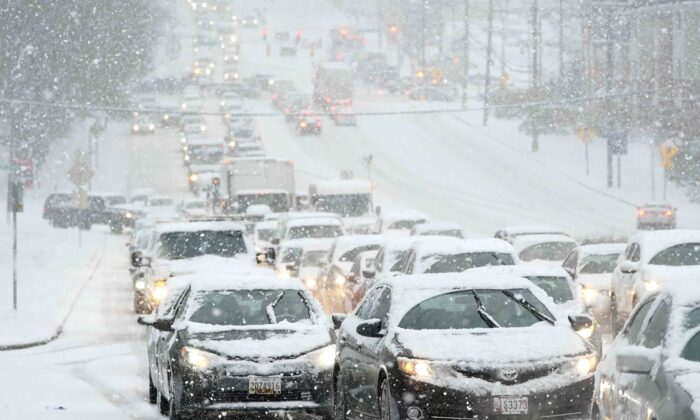 A traffic jam is caused by vehicles stuck on a hill during a snowstorm in Towson, Md., on Dec. 16, 2020. (AP Photo/Julio Cortez)