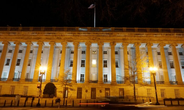 A vehicle drives past the U.S. Treasury Department in Washington, on Dec. 13, 2020. (Raphael Satter/Reuters)