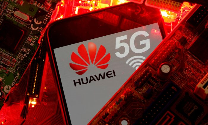 A smartphone with the Huawei and 5G network logo is seen on a PC motherboard in this illustration picture taken on Jan. 29, 2020. (Dado Ruvic/Reuters)