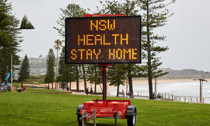 A Covid-19 digital sign is seen on Dee Why beachfront in Sydney, Australia on Dec. 19, 2020. (Lee Hulsman/Getty Images)