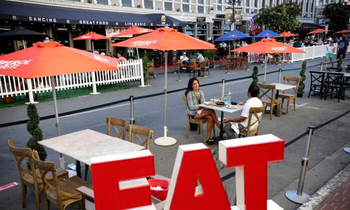 Patrons dine at an outdoor restaurant along 5th Avenue in The Gaslamp Quarter in downtown San Diego, Calif., in a July 17, 2020, file photograph. (Sandy Huffaker/AFP via Getty Images)