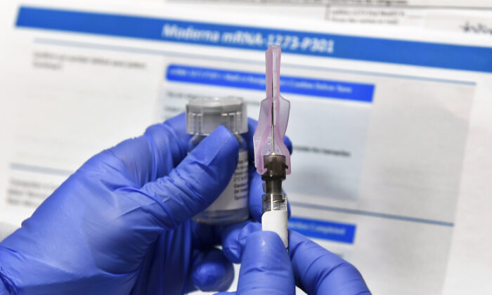 A nurse prepares a shot of a COVID-19 vaccine candidate developed by the National Institutes of Health and Moderna, in Binghamton, N.Y., on July 27, 2020. (Hans Pennink/AP Photo)