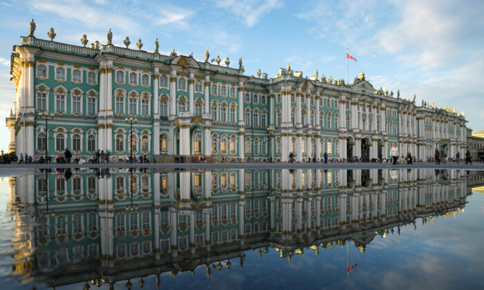 The Baroque-style Winter Palace in St. Petersburg, Russia, is reflected in a puddle on Palace Square. (Roman Sibiryakov/Shutterstock.com)