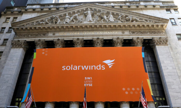 SolarWinds Corp banner hangs at the New York Stock Exchange on the IPO day of the company in New York, on Oct. 19, 2018. (Brendan McDermid/Reuters)