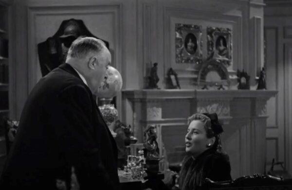 Man talking to woman in fancy house
