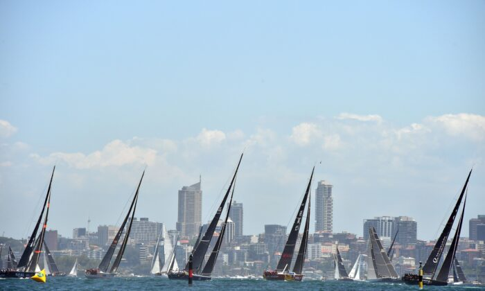 Yachts sail out of Sydney Harbour at the start of the Sydney to Hobart yacht race on Dec. 26, 2018. (Peter Parks/ AFP)