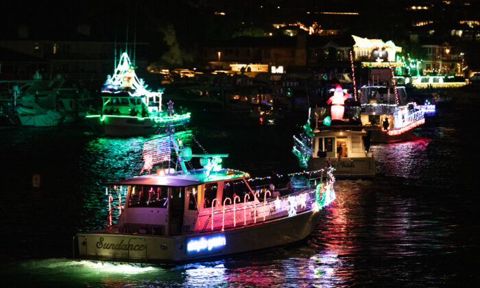Boats decorated with lights participate in the 'Unofficial' Newport Harbor Christmas Boat Parade in Newport Beach, Calif., on Dec. 17, 2020. (John Fredricks/The Epoch Times)