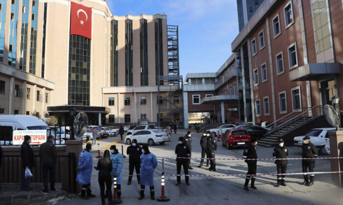 Police and medics gather outside the privately-run Sanko University Hospital in Gaziantep, Turkey, on Dec. 19, 2020.  (Kadir Gunes/DHA via AP)