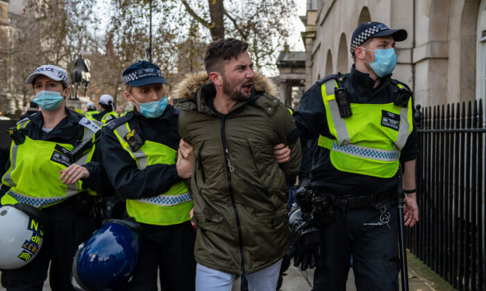 A man is arrested during an anti lockdown protest in London on Dec. 19, 2020. (Chris J Ratcliffe/Getty Images)