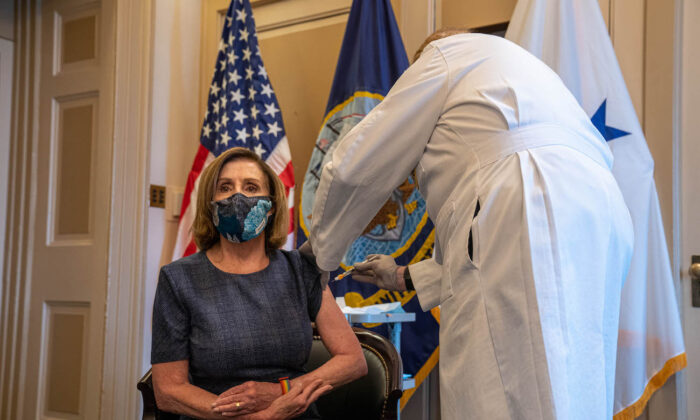 Speaker of the House Nancy Pelosi (D-Calif.) receives a COVID-19 vaccination shot by Dr. Brian Monahan, attending physician of the Congress of the United States, in her office on Capitol Hill in Washington on Dec. 18, 2020. (Ken Cedeno-Pool/Getty Images)