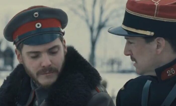 """German Lt. Horstmayer (Daniel Brühl, L) and French Lt. Audebert find a good deal to bond over despite their fighting on opposite sides during World War I, in """"Joyeux Noël."""" (Sony Pictures Classics)"""