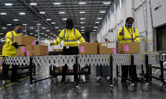 Boxes containing the Moderna COVID-19 vaccine are prepared to be shipped at the McKesson distribution center in Olive Branch, Miss., on Dec. 20, 2020. (Paul Sancya/Pool via Reuters)