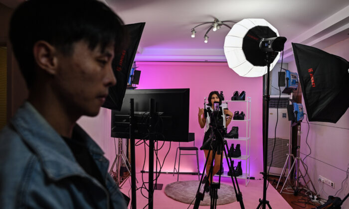 Silvia Rivera (in background) attending a livestreaming event from a studio in Shanghai to offer products on an Aliexpress channel in Spain, on October 23, 2020. (HECTOR RETAMAL/AFP via Getty Images)