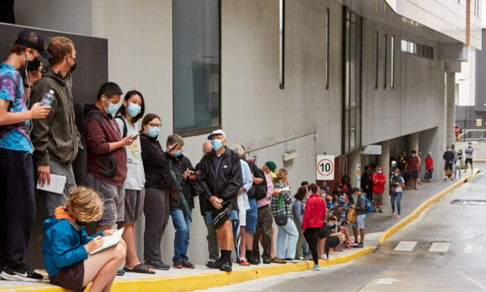 People waiting in long lines for Covid-19 tests at the Brookvale Centre in Sydney, Australia on Dec. 19, 2020. (Lee Hulsman/Getty Images)
