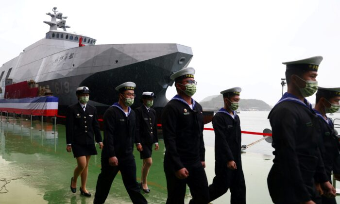 Navy officers march during the official ceremony for the new Tuo Chiang-class corvettes in Yilan, Taiwan, on Dec.15, 2020. (Ann Wang/Reuters)