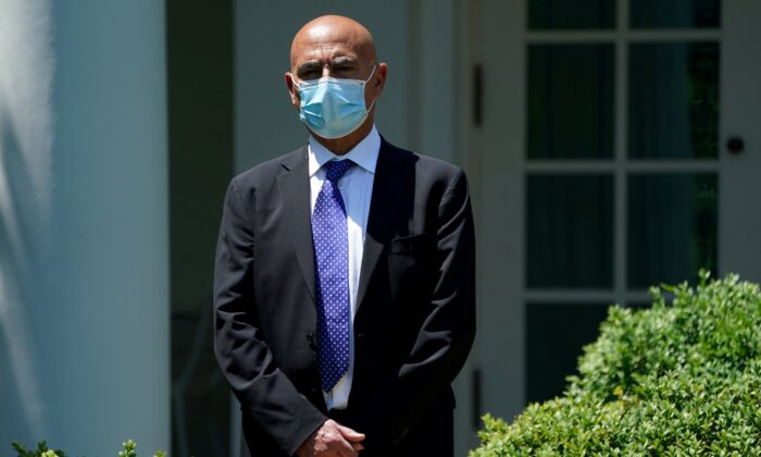 Former GlaxoSmithKline pharmaceutical executive Moncef Slaoui, now President Donald Trump administration's vaccine czar, stands outside the White House in Washington on May 15, 2020. (Kevin Lamarque/Reuters)