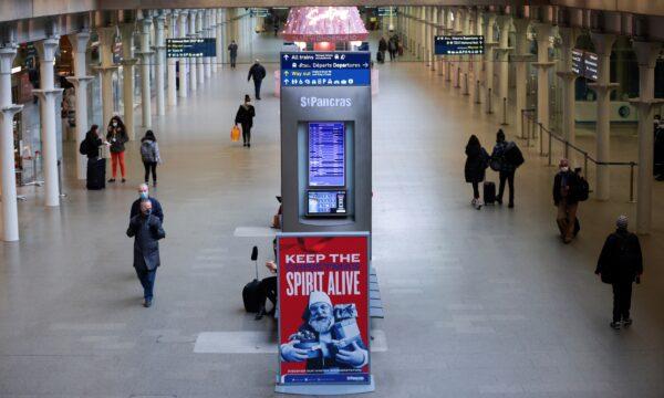 Travellers walk through St Pancras International