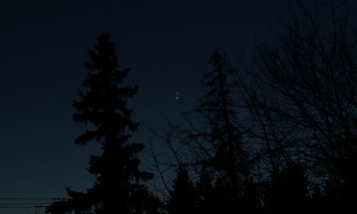 "During a holiday season that due to the global pandemic is unlike any other, astronomers and ordinary Canadians will look skyward Monday evening for a celestial event dubbed ""The Christmas Star"" which hasn't been so brilliant for close to eight centuries. The planets Saturn and Jupiter are seen in the night sky from Edmonton, on Dec. 20, 2020. (The Canadian Press/HO-Brian Martin)"