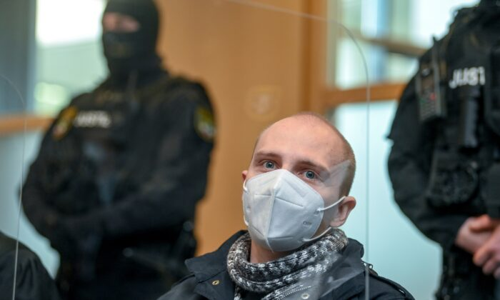 The defendant Stephan Balliet sits in the courtroom of the district court on the 26th day of the trial before the court's verdict in Magdeburg, Germany, on Dec. 21, 2020. (Hendrik Schmidt/Pool via AP)