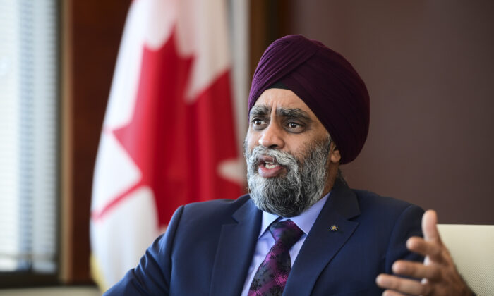 Minister of National Defence Harjit Sajjan speaks to a reporter at National Defence Headquarters in Ottawa on  Dec. 17, 2020. (Sean Kilpatrick/The Canadian Press)