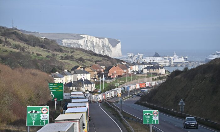 Freight lorries queue on the main route into the port of Dover on the south coast of England on Dec. 18, 2020. (Ben Stansall/AFP via Getty Images)