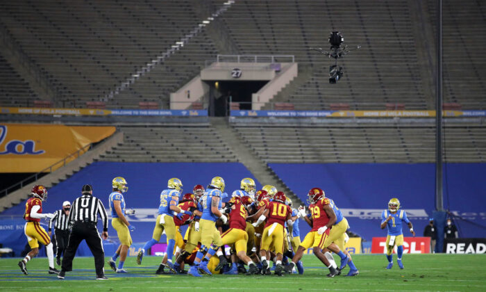 The University of Southern California (USC) Trojans and the University of California–Los Angeles (UCLA) Bruins play in a cross-town rivalry game to no fans at the Rose Bowl in Pasadena, Calif., on Dec. 12, 2020. (Sean M. Haffey/Getty Images)