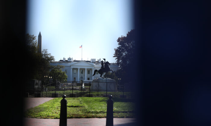 The White House, seen through a fence on H Street by Lafayette Square, on Nov. 2, 2020. (Charlotte Cuthbertson/The Epoch Times)