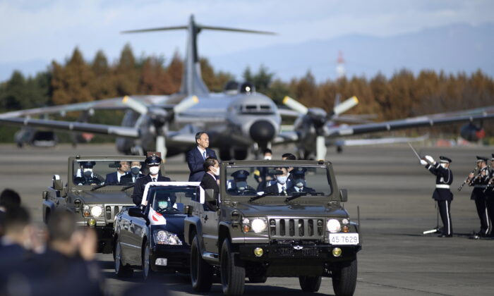 Japanese Prime Minister Yoshihide Suga reviews Japan's Air Self-Defense Force at Iruma Air Base in Sayama, Saitama Prefecture, Japan, on Nov. 28, 2020. (David Mareuil/File Photo/Pool via Reuters)