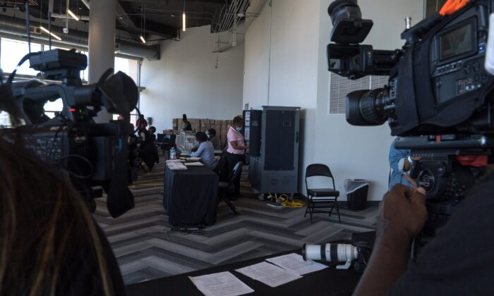Media crews film while election workers process absentee ballots at State Farm Arena in Atlanta, Ga., on Nov. 2, 2020. (Megan Varner/Getty Images)