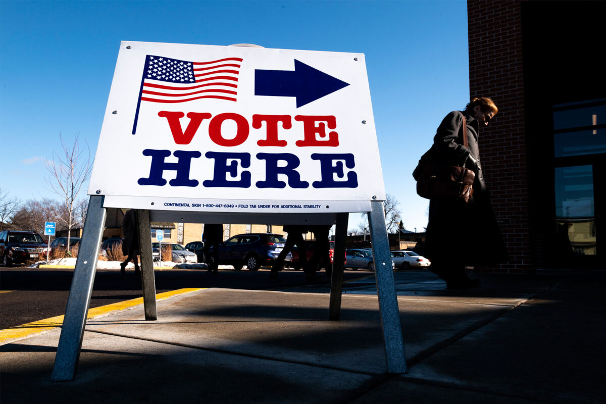 A voter arrives at a polling place