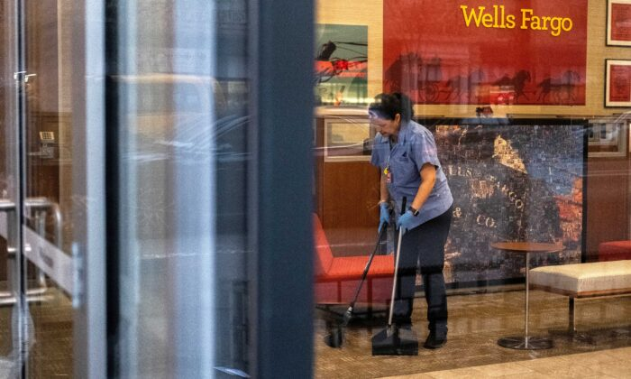 A staff cleans the lobby inside Wells Fargo bank in New York City on March 17, 2020. (Jeenah Moon/Reuters)
