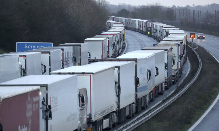 Trucks are parked along the M20 motorway where freight traffic is halted whilst the Port of Dover remains closed, in Ashford, Kent, England, on Dec. 22, 2020. (Andrew Matthews/PA via AP)