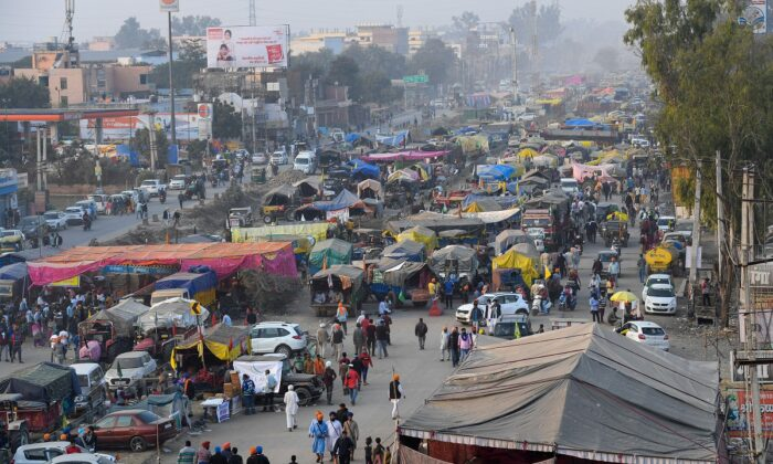 A general view of parked tractor trolleys and trucks of protesting farmers is pictured along a blocked highway during a demonstration against the central government's recent agricultural reforms at the Delhi-Haryana state border in Singhu on December 10, 2020. (Prakash Singh/AFP via Getty Images)