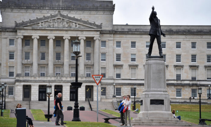 People in front of Stormont House in Belfast, Northern Ireland, on May 19, 2020. (Charles McQuillan/Getty Images)